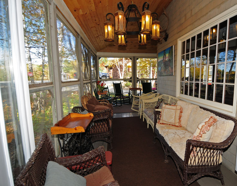 Big Moose Inn - Screened Porch with seating for relaxing